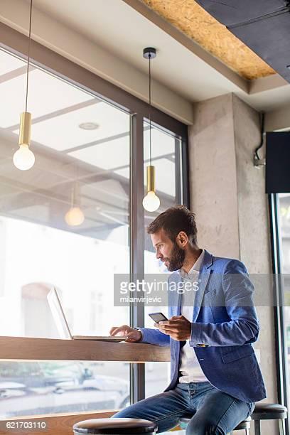 Handsome businessman working on a coffee break
