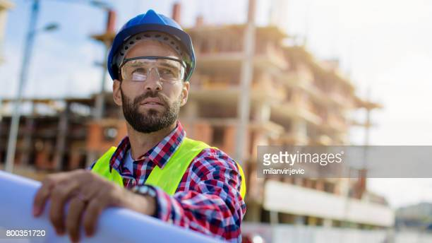 Handsome construction worker at construction site