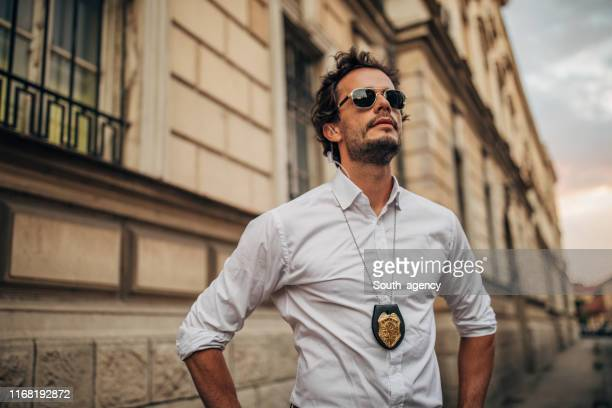 handsome detective on the street - sheriff stock pictures, royalty-free photos & images