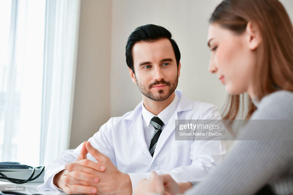 Shot Of A Doctor Examining A Senior Woman With A Blood
