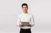 handsome elegant asian young male coworker
