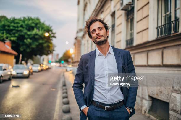 handsome elegant man on the street - hands in pockets stock pictures, royalty-free photos & images