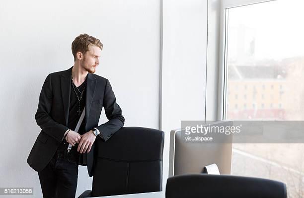 Handsome Elegant Office Employee Looking Outside The Window