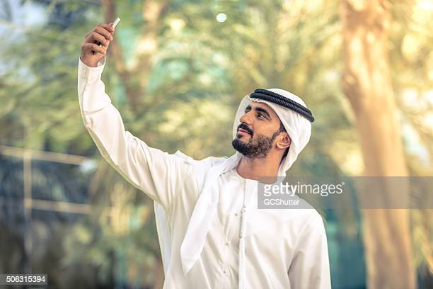 Handsome Emirati Man taking Selfie