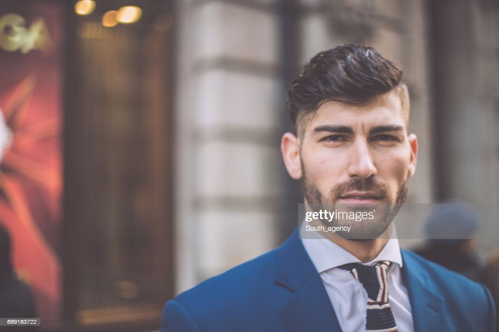 Handsome fashion model in suit : Stock Photo