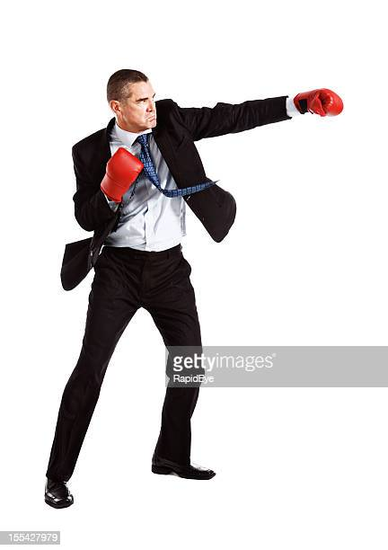 handsome frowning businessman wearing boxing gloves is on the attack - funny boxing stock photos and pictures