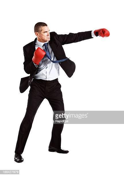 handsome frowning businessman wearing boxing gloves is on the attack - slaan met vuist stockfoto's en -beelden