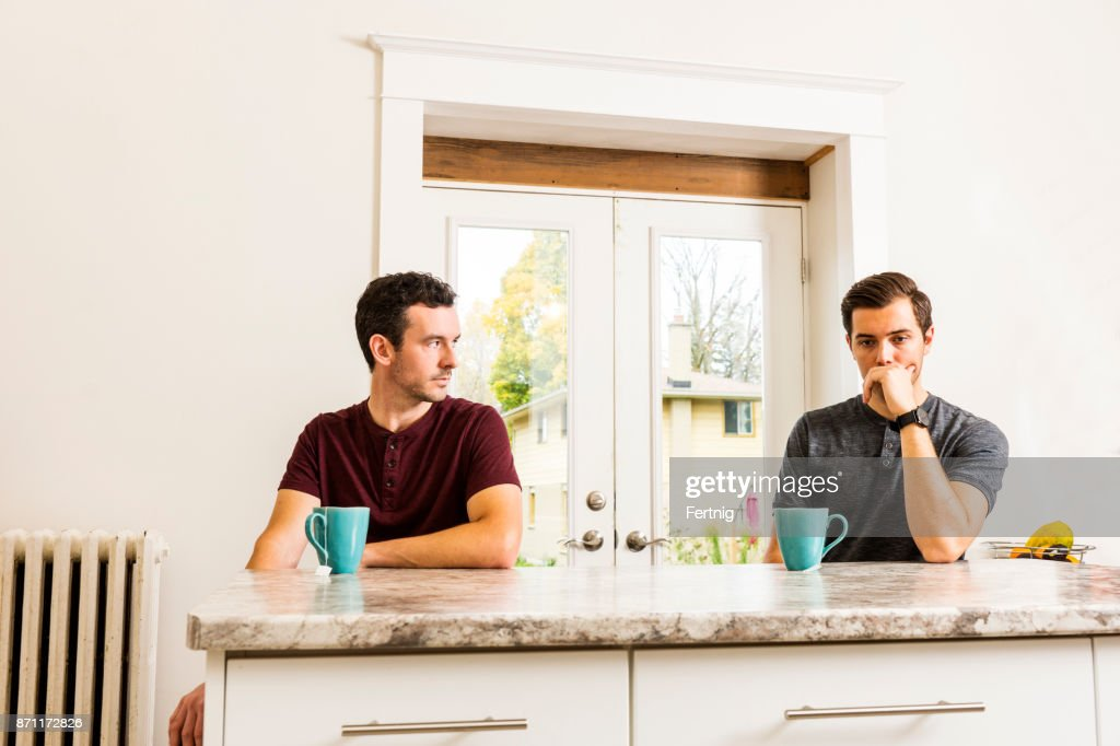 A handsome gay couple experiencing relationship issues. : Stock Photo