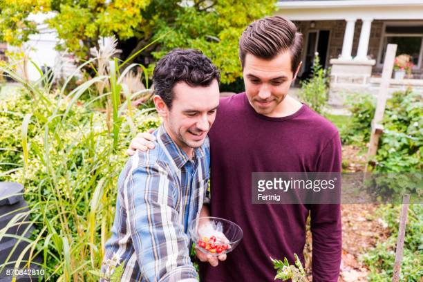 handsome-gay-couple-in-the-garden-togeth