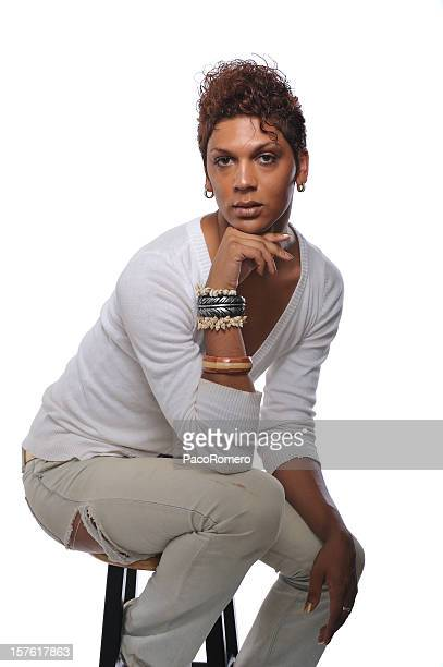 handsome gay man sitting on stool - young crossdressers stock photos and pictures
