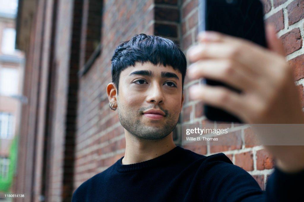Handsome Gay Man Taking a selfie : ストックフォト
