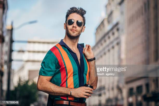 handsome gentleman downtown - sunglasses stock pictures, royalty-free photos & images