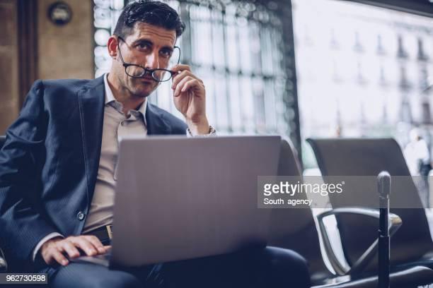 Handsome gentleman using laptop