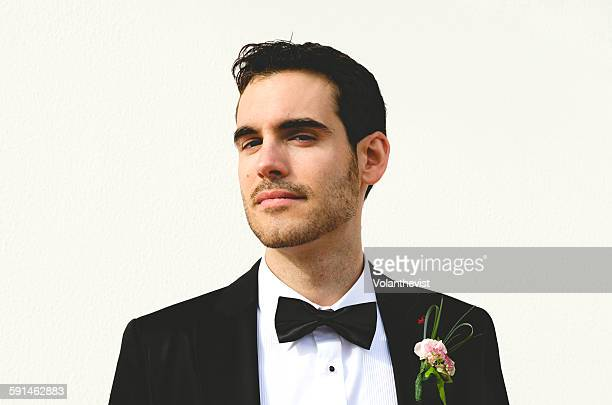 handsome groom on white background - smoking jacket stock photos and pictures