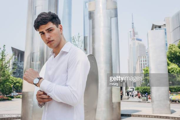 handsome guy in white shirt - white shirt stock pictures, royalty-free photos & images