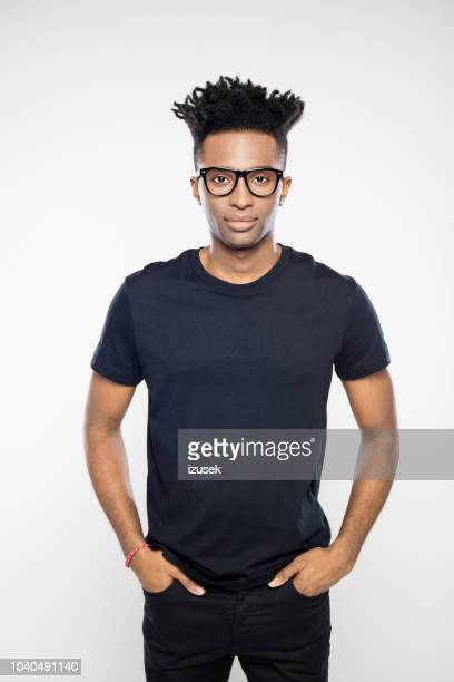 handsome guy with funky hairstyle and nerd glasses - t shirt preta imagens e fotografias de stock