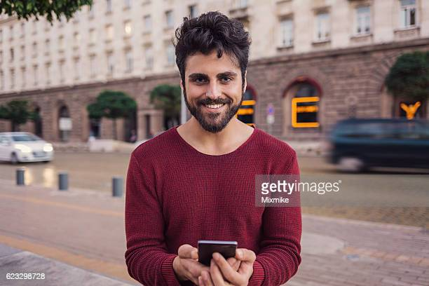 Handsome guy with smartphone