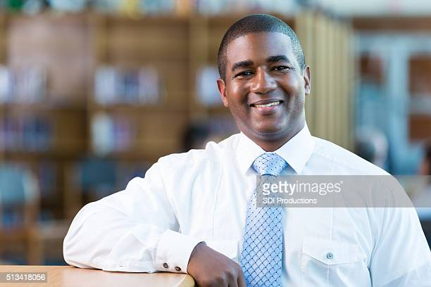 Handsome high school teacher in school library