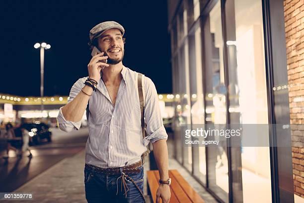 Handsome hipster on mobile