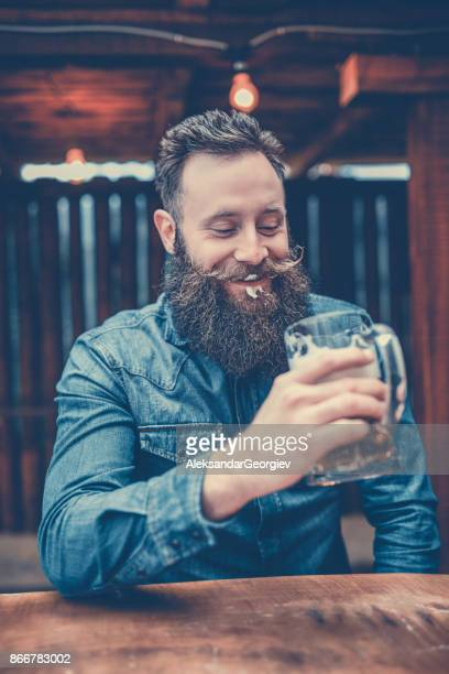Handsome Hipster Person Drinking Beer In Pub