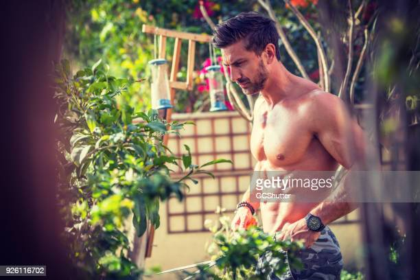 Handsome hunk with gardening forks