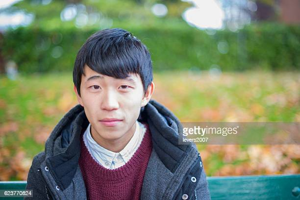 handsome japanese student in autumn - funky stock pictures, royalty-free photos & images