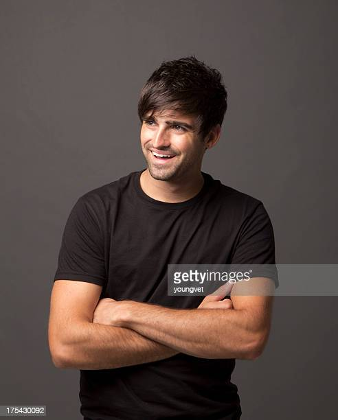 Handsome laughing young man with black shirt