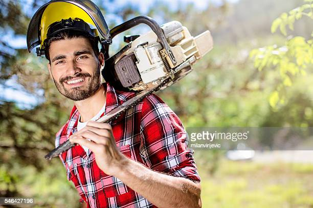 Handsome lumberjack with chainsaw