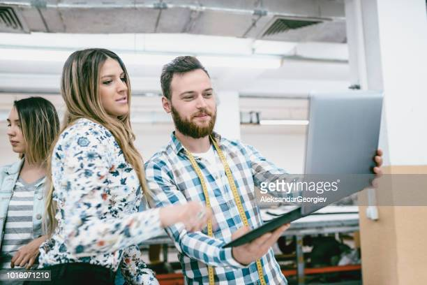 Handsome Male Designer Showing New Project To Factory Owner