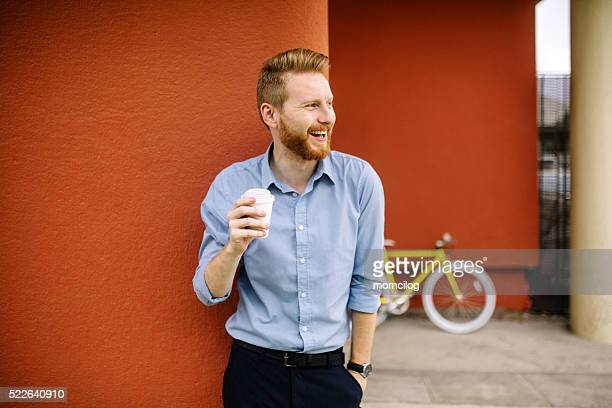Handsome male drinking coffee