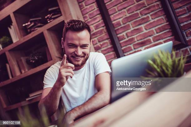 handsome male explaining plant care procedure - webcam stock photos and pictures