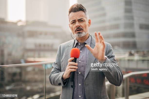handsome male reporter in live broadcasting relays today's news - journalist stock pictures, royalty-free photos & images
