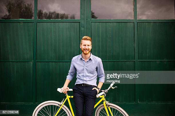 Handsome male with modern bicycle