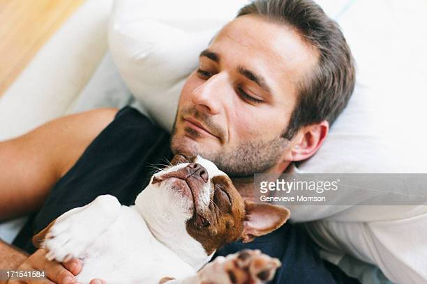 Handsome man and red boston terrier
