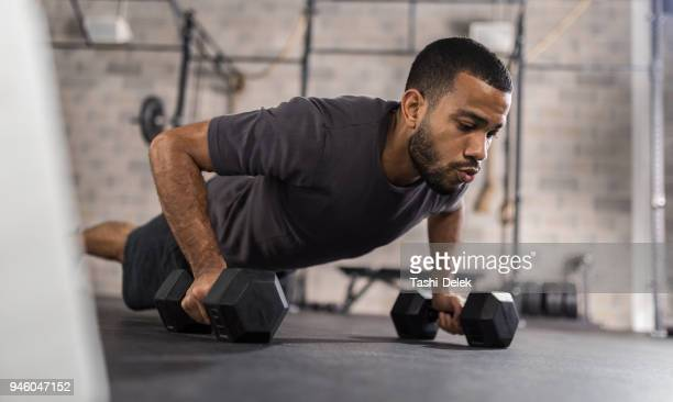 handsome man doing push ups exercise - sports training stock pictures, royalty-free photos & images