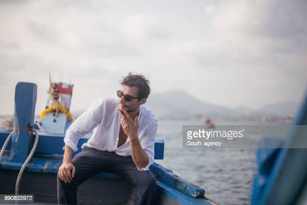 Handsome man enjoying a boat ride