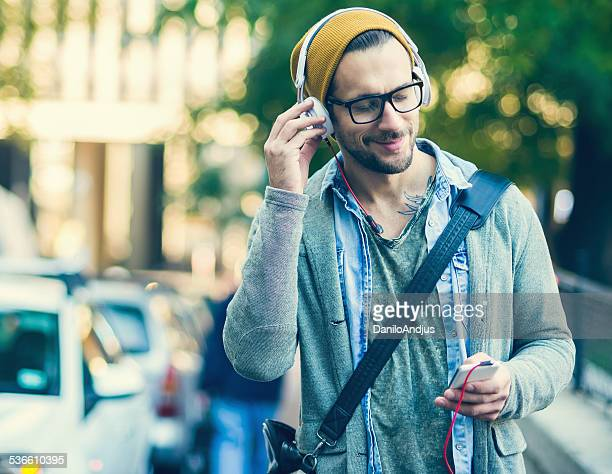 handsome man enjoying and listening to music