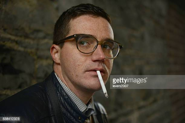 Handsome man having a cigarette