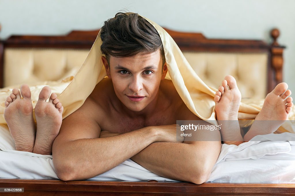 Handsome Man In Bed With Two Women : Stock Photo
