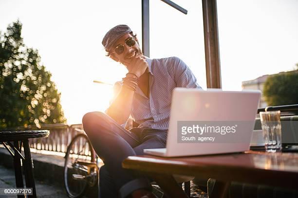 Handsome Man in cafe on laptop