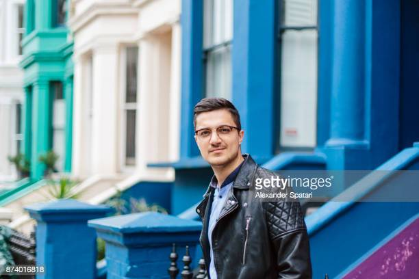 Handsome man in glasses on the streets of Notting Hill, London, UK
