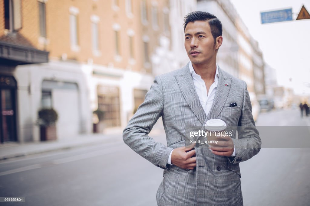 Handsome man in gray suit : Stock Photo