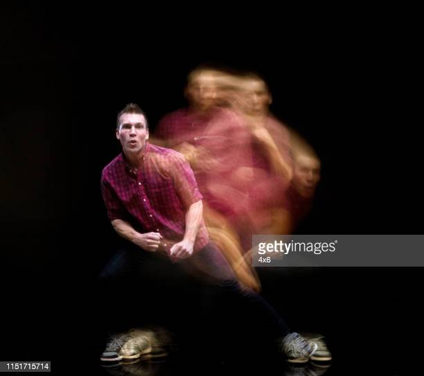 handsome man in motion blur - long exposure stock pictures, royalty-free photos & images