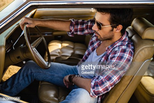 Handsome Male Model Posing In Car Stock Photo Getty Images