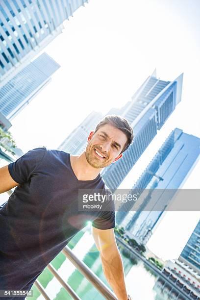 Handsome man in the city enjoying morning