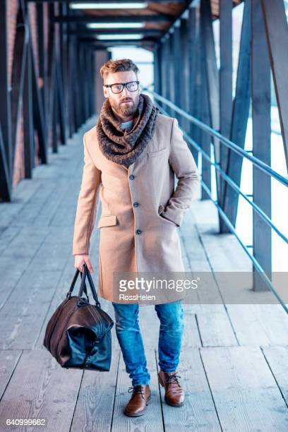 handsome man in winter elegant clothes outdoors - abiti pesanti foto e immagini stock