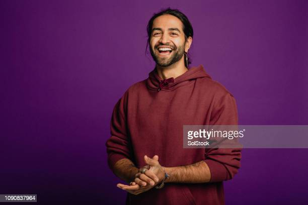 handsome man laughing - purple background stock photos and pictures