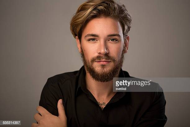 handsome man looking at camera. - model stock photos and pictures