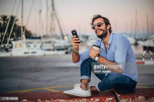 handsome man on coffee break - suave stock pictures, royalty-free photos & images