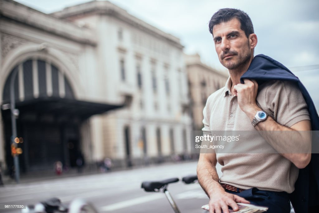 Handsome man on the city street : Stock Photo